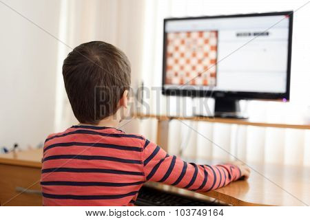 Little Boy Playing On Pc Chess