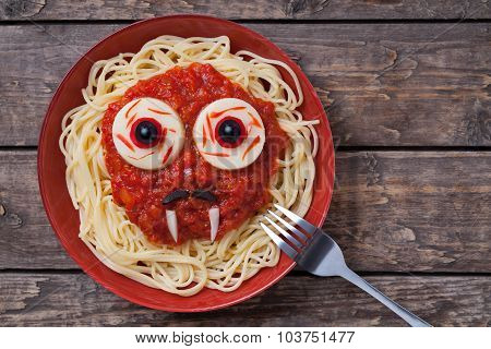Funny halloween vampire face food for celebration party. Scary monster with big eyes, fangs and mous