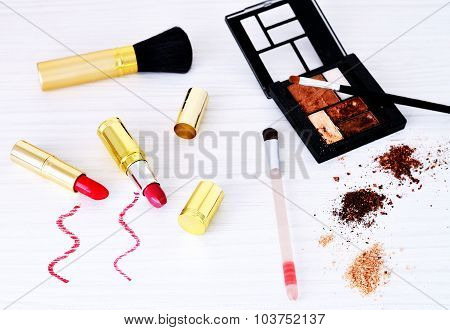 Varied cosmetics on the white table selective focus