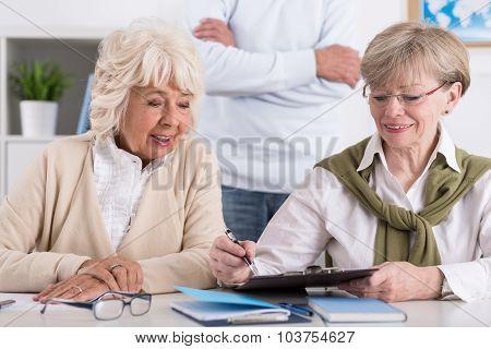 Elderly Female Friends Studying Together