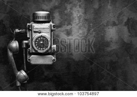 Industrial metal phone on a dark wall.