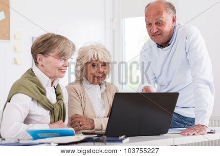 Elderly Students Sitting Beside Laptop