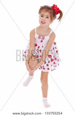 little girl in a short dress