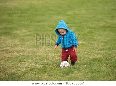 Baby Playing With Ball.