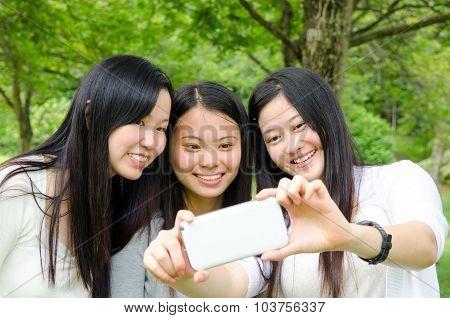 Asian young women taking a selfie