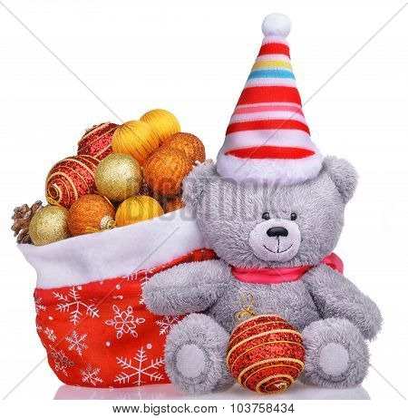 Funny Teddy Bear In Hat With Santa Claus Bag Full Of Toys