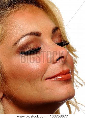 Closeup View Of A Blond Model With Her Eyes Closed.