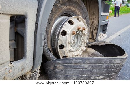 Damaged 18 Wheeler Semi Truck Burst Tires By Highway Street, With Blurred Driver