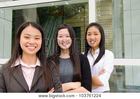 Cheerful asian young executives