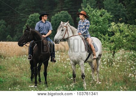 Couple riding in forest