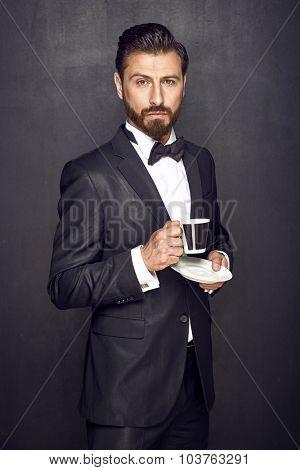 Elegant man drinking coffee