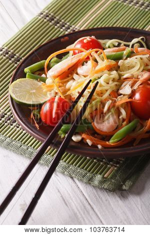 Papaya Salad Som Tam With Shrimp Close-up On A Plate. Vertical