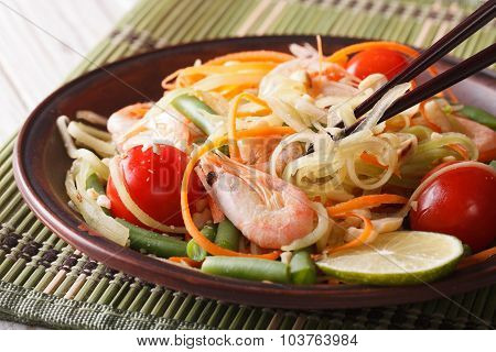 Thai Green Papaya Salad Som Tam Closeup. Horizontal