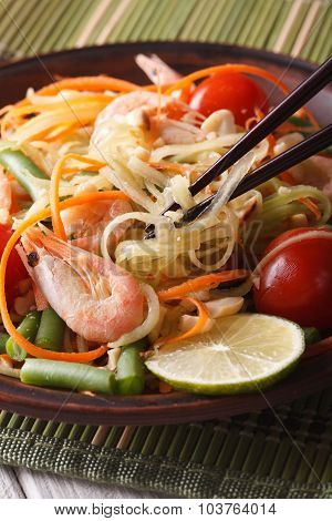 Thai Green Papaya Salad Som Tam Closeup. Vertical