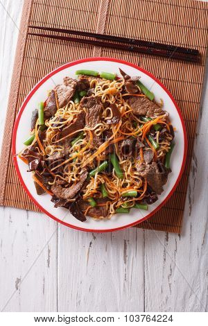 Chinese Noodles With Beef, Muer And Vegetables. Vertical Top View