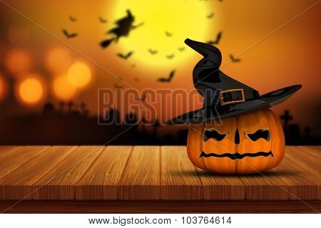 3D render of a Halloween pumpkin on a wooden table with a defocussed spooky graveyard image in the background