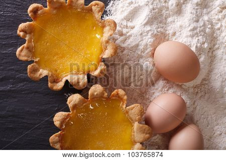 Egg Tart And Ingredients Close-up On The Table. Horizontal Top View