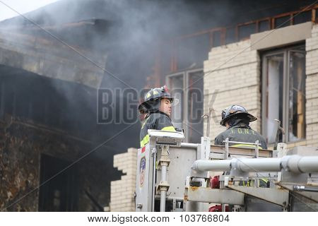 Fire fighters amid smoke