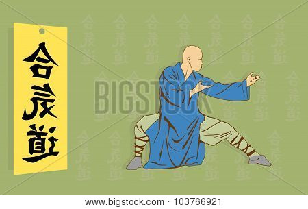 The Man Shows Kung Fu Against A Hieroglyph.