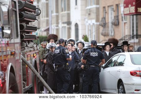 Hasidim confront blocked streets