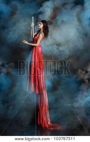 Girl High On A Pole Wrapped In Smoke.