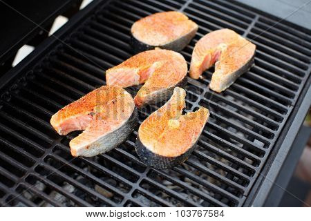 Salmon fish roast on barbecue grill. Cooking.