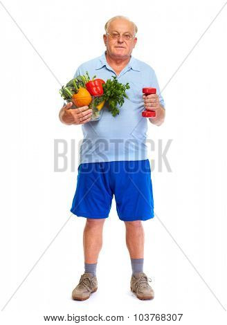 Senior man with dumbbell and vegetables isolated over white background.