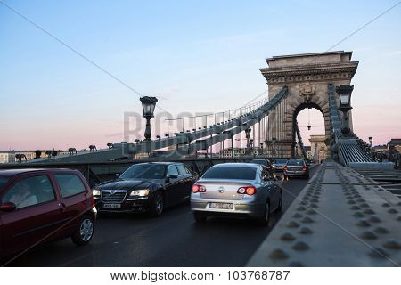 BUDAPEST, HUNGARY - SEPT 20, 2015: Traffic on the Chain Bridge in Budapest. Opened on 20 Nov 1849, Bridge became one of incentives of unification of Buda and pest into one city Budapest.