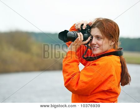 Photographer  Taking Photo With Photocamera