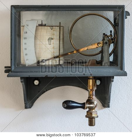 old retro hygrometer weather station at wall