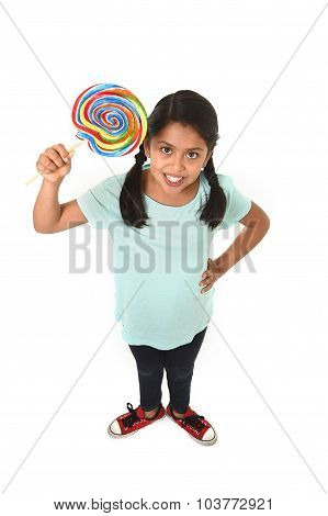 Child Holding Big Lollipop Candy In Cheerful Face Expression In Sugar Addiction