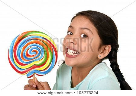 Happy Female Child Holding Big Lollipop Candy In Cheerful Face Expression In Kid Love For Sweet Conc