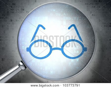 Studying concept: Glasses with optical glass on digital background