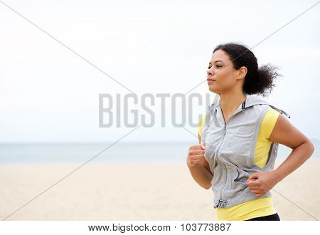 Fit Young Woman Running By The Beach