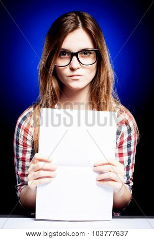 Young Girl With Exercise Book Looking Through The Nerd Glasses