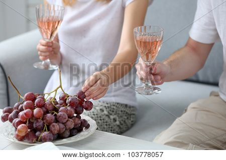 Friends hands with glasses of wine and snacks , close up