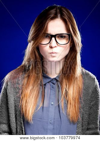 Strict Young Woman With Nerd Glasses And Granny Sweater