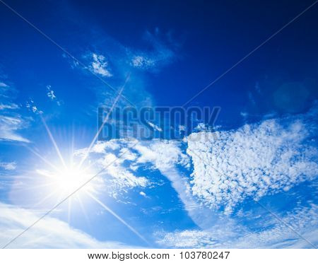 sun in a blue cloudy sky