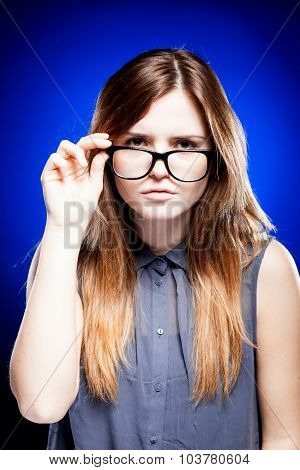 Young Woman Looking Through The Nerd Glasses
