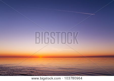 Beautiful view of the sunset over a sea