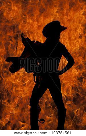 Silhouette Of A Cowgirl Holding Saddle On Shoulder