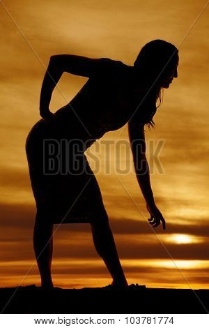 Silhouette Of A Woman In Tight Dress Bend Down