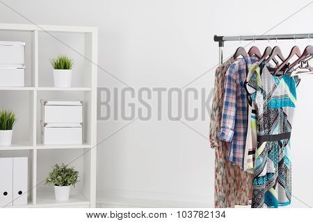 Colorful Clothes On Hanger In White Room