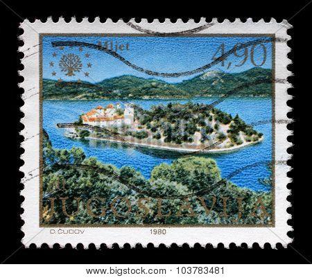YUGOSLAVIA - CIRCA 1980: A stamp printed in Yugoslavia shows the island of Mljet, Adriatic sea, Croatia, circa 1980.