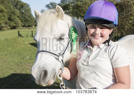 Girl With Prize Winning Pony In Field
