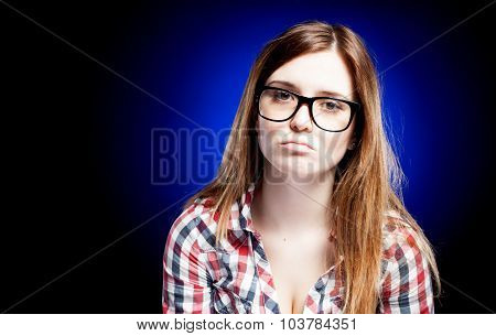 Disappointed And Sad Young Girl With Large Nerd Glasses