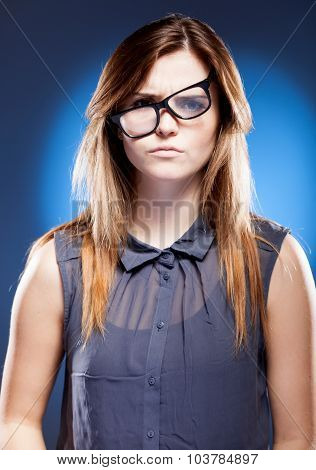 Disappointed Young Woman With Nerd Glasses Has Objections