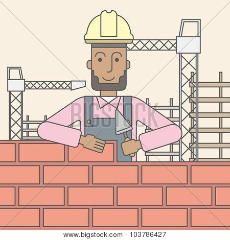 A smiling black builder wearing a hard hat building a brick wall. Vector line design illustration. Square layout.