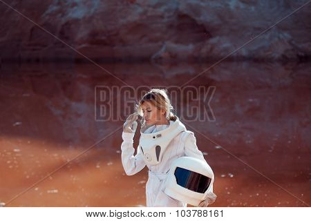 Water on Mars, futuristic astronaut without a helmet in another planet, image with the effect of ton