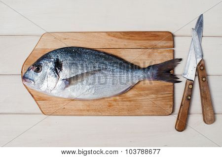 Raw Fish On The White Wooden Table